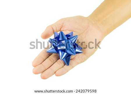 Gift bow in hand holding isolated on white background - stock photo