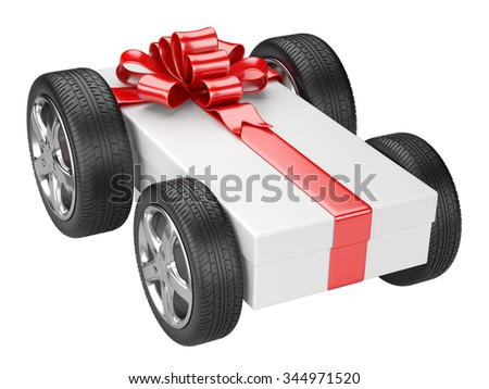 Gift box and a tyre wheels isolated on a white background - stock photo