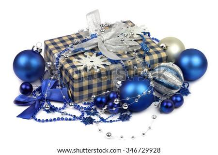 Gift box and blue balls for Christmas - stock photo
