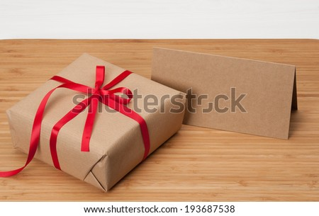 Gift Box And Card On Wooden Background - stock photo