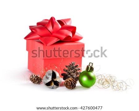 Gift box and christmas decoration, with christmas tree ball and pine cones. isolated on white background with copy space.