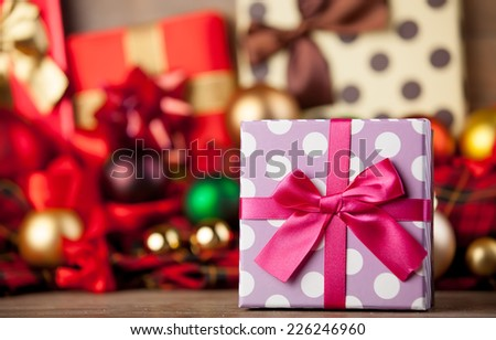 Gift box and christmas gifts on background. - stock photo