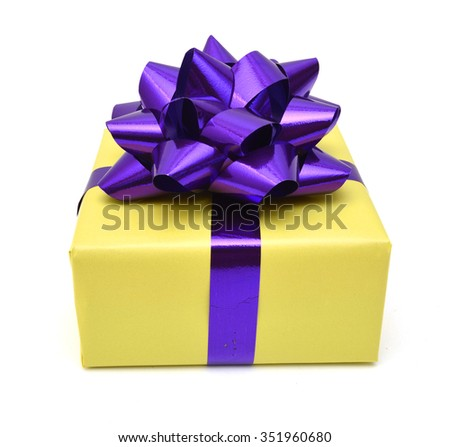 Gift box and purple bow on white background  - stock photo