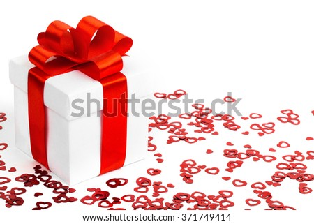 Gift box, bow and heart on a white background. studio shot