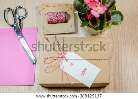 Gift box,cards,Begonia on the wooden background