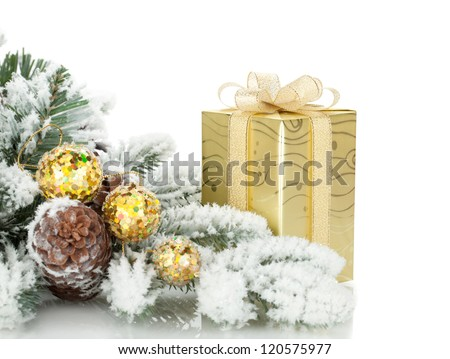 Gift box, christmas decor and snowy fir tree. Isolated on white background