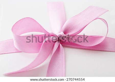 gift box. close-up of pink ribbon bow - stock photo