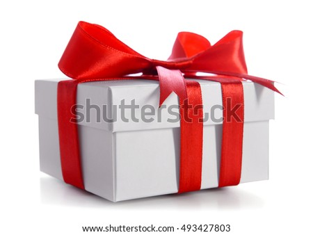 Gift box decorated with red ribbon and big bow isolated on white