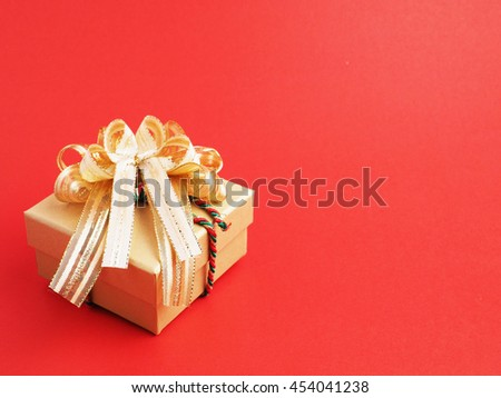 Gift box for important day on red background, christmas and new year idea, close up.