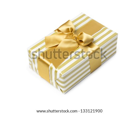 Gift box in gold duo tone with golden satin ribbon and bow isolated over white background. - stock photo