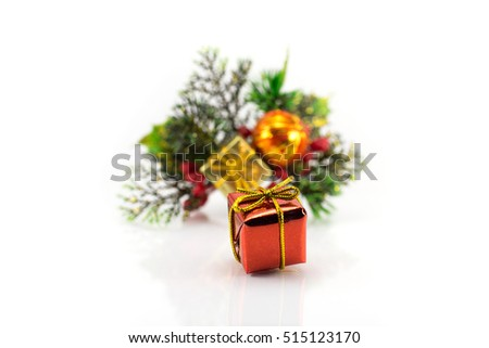 Gift box on a background of branches of the Christmas tree with toys and gifts