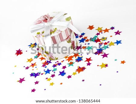 gift box on a background of confetti