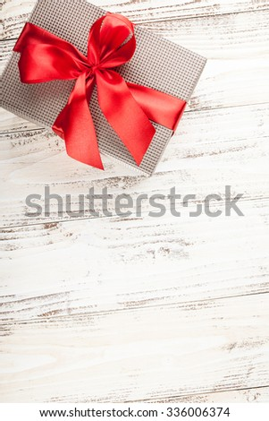 Gift box on a rustic wooden table