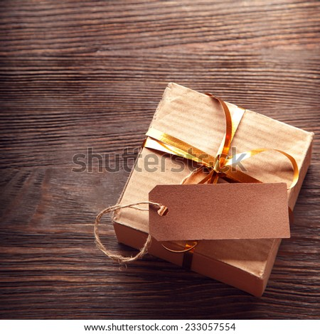 Gift box on a wooden background space for lettering - stock photo