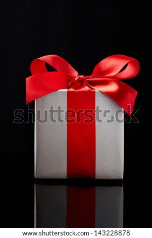 gift box on black background.  Gift box with origami bows.  - stock photo