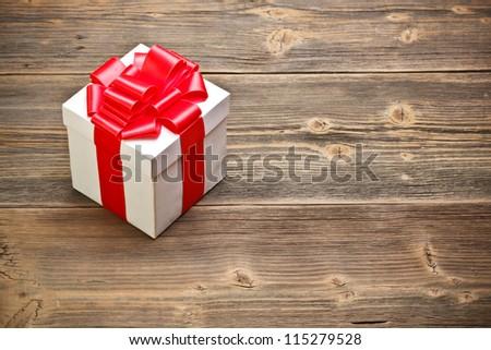 Gift box on old wood. - stock photo