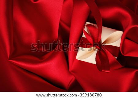gift box on red silk background. valentines day - stock photo