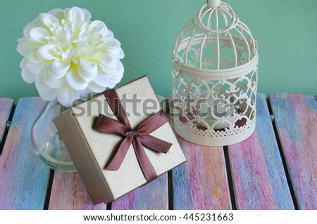 Gift box on vintage wooden board