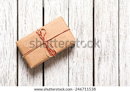 Gift box on white wood table. With a lot of copy space. - stock photo