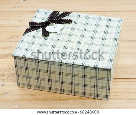 Gift Box on wooden background - stock photo