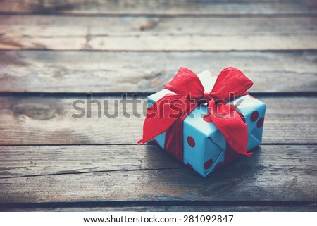 gift box on wooden table as natural background with copyspace