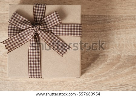 Gift box on wooden table with copy space, top view