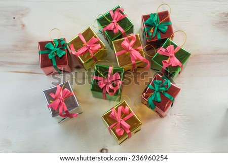 Gift box package on wooden background