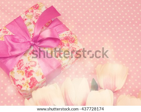 gift box present and flowers decoration background with vintage filter color