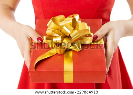 Gift Box Present With Ribbon And Bow, Woman Holding Red Presents In Hands, White Background - stock photo