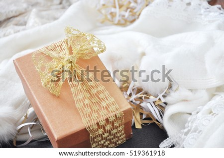 Gift box put on white scarf background