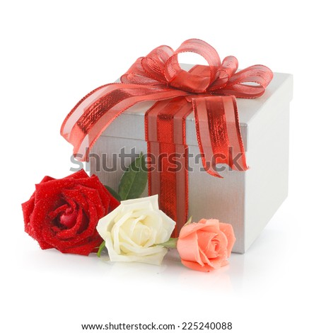 Gift box tied a red ribbon and bow with rose flower isolated on white background. This has clipping path.