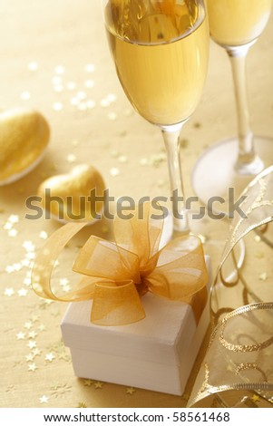 gift box tied with a gold ribbon bow - stock photo