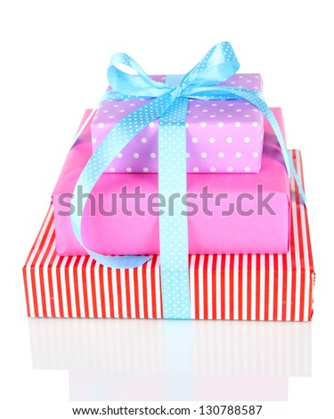 Gift box tied with a ribbon isolated on white