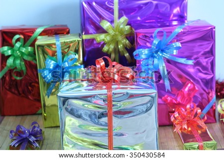 Gift box tied with colorful ribbons, arrange them together