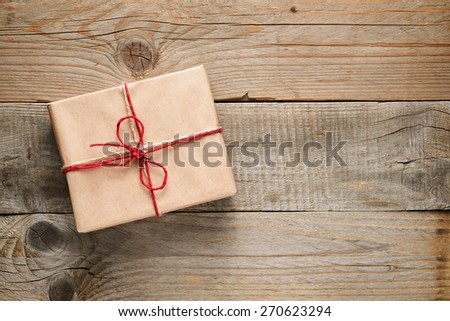 Gift box top view on wooden background - stock photo