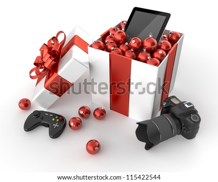 Gift box with a camera, a gamepad and a tablet surrounded by Christmas balls - stock photo