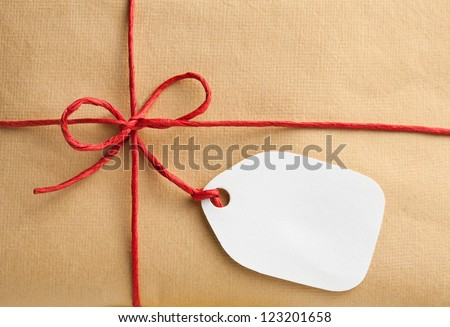 Gift box with blank gift tag - stock photo