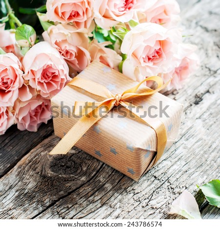 Gift Box with Bowl and Pink Roses on Wooden Table, image square - stock photo