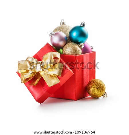 gift box with  christmas balls and gold bow ribbon on white background clipping path included - stock photo