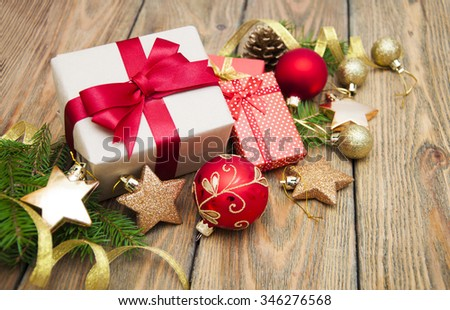 Gift box with Christmas decorations and Christmas tree on a wooden background