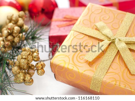 Gift box with christmas present ans decor horizontal - stock photo