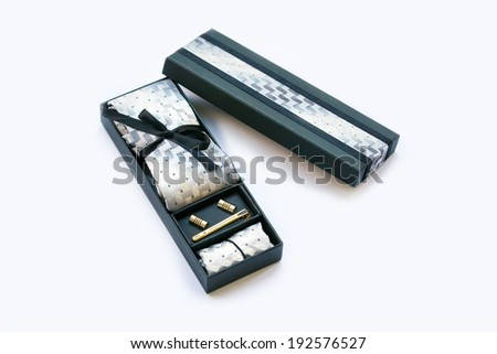 Gift box with cuff links, tie and tie clip, handkerchief.