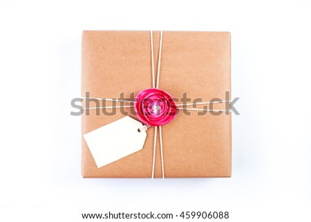 Gift box with fabric flower and gift tag isolated on white background