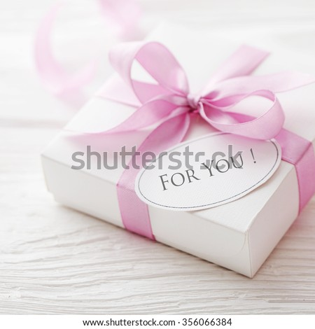 gift box with gift tag. pink satin gift bow - stock photo
