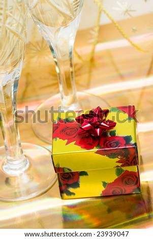 gift box with glasses of champagne