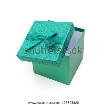 gift box with green ribbon on a white background