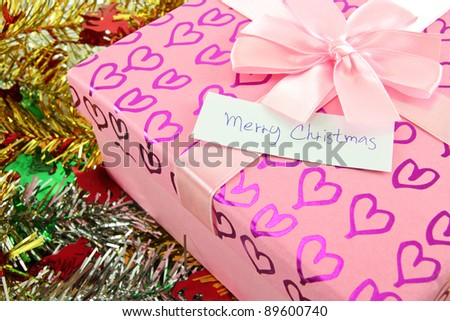 gift box with merry Christmas label - stock photo