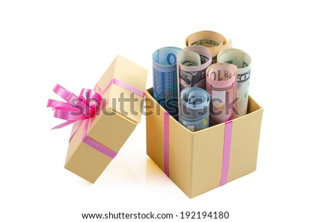 Gift box with money on light background - stock photo