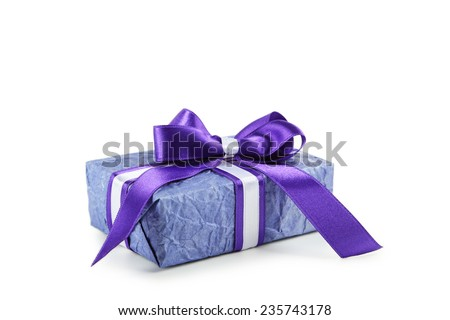 Gift box with purple bow isolated on white - stock photo