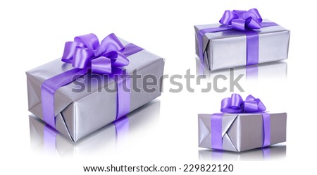 Gift box with purple ribbon on white background  - stock photo